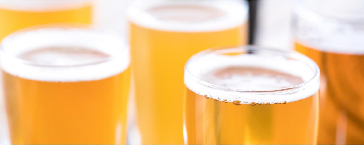 filled beer glasses